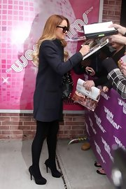 Lauren Conrad left 'The Wendy Williams Show' wearing a pair of black platform pumps with her chic navy jacket.