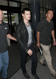 The dreamy young actor looked stylish in a classic leather motorcycle jacket with lace up boots and skinny pants.