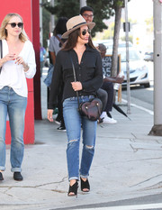 For her shoes, Lea Michele chose a pair of black peep-toe slingbacks by Aquazzura.