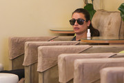 Lea Michele kept her shades on while having her nails done.