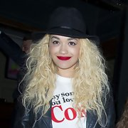 Rita Ora departed from her typical beanie and opted for this black walker hat a la Johnny Depp-style.