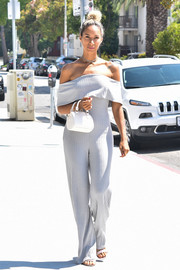 Leona Lewis wowed on the streets of LA in a trendy gray off-the-shoulder jumpsuit.