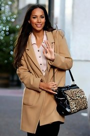 Leona Lewis gave her winter attire an exotic touch with a black patent and leopard print tote.