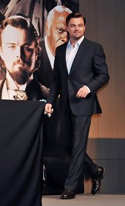 Leonardo DiCaprio matched brown leather slip-on shoes with his charcoal suit when he attended the 'Django Unchained' press conference.