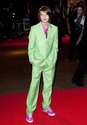 Kodi makes a bold statement in a lime green three piece suit. A pink button-down shirt, matching tie and patent Nike shoes give him a watermelon inspired look.