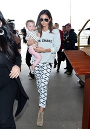 Lily Aldridge chose a pair of black-and-white geometric-print pants to team with her sweater.