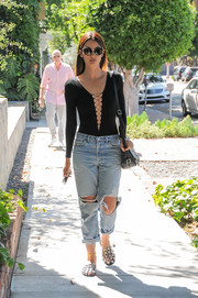Lily Aldridge ran errands in sexy style wearing this T by Alexander Wang deep-V lace-up bodysuit.