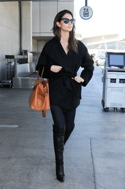 Lily Aldridge looked very cosmopolitan in a black wool coat and skinny jeans during her flight to LAX.
