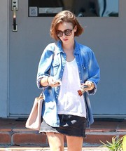 Lily Collins was spotted outside a spa looking pretty in her butterfly sunnies.