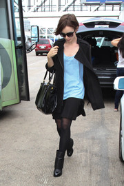 For a bit of warmth to her airport look, Lily Collins wore a black zip-up jacket, also by Pleione.