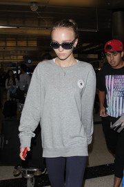 Lily-Rose Depp arrived on a flight at LAX looking edgy in studded sunglasses.
