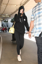 Lily-Rose Depp stayed comfortable in a pair of black leggings.