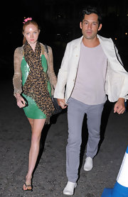 Lily Cole teamed a leopard-print scarf with a shimmery green mini dress and a cardigan for an eclectic finish.