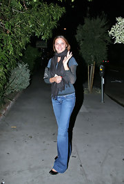 Adriana opted for comfort, in a black patent leather ballet flats.