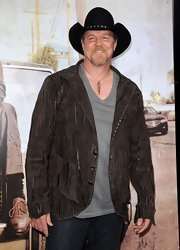 Trace Adkins attended the 'Lincoln lawyer' premeire wearing a black cowboy hat which went perfectly with his fringe jacket.