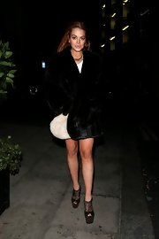 Lindsay bared her legs but kept her body warm in this plush fur coat.