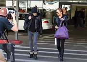 Shielding her face from the photogs. Samantha Ronson makes her way out of LAX airport sportin these studded leather combat boots. Samantha normally opts for an edgy all black look and these studded boots certainly add edge but give her ensemble some flare.