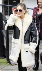 Perrie Edwards was rocker-glam in a fur and leather coat as she left the ITV Studios.