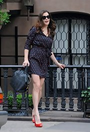 Liv added retro flair to her sweet polka dot wrap dress with red Devalavi peep-toes.