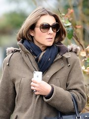Elizabeth Hurley bundled up with this navy print scarf while out in London.