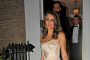Liz Hurley and her husband Arun Nayar leave to attend the Elton John AIDS Foundation Winter Ball.