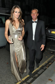 Elizabeth Hurley accessorized her gleaming platinum gown with a glittery silver clutch.