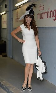Lizzie Cundy sported a solid white fitted sheath dress while out at the races.