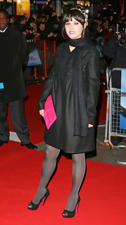 Zooey Deschanel matched her girlish hot pink clutch to the bright soles of her black peep-toes.