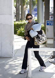 With pillow in hand Eva longoria Parker made her way through LAX airport toting a coveted metallic handbag.