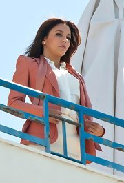 Eva Longoria looked stunning in this dusky pink blazer on the roof of the Hotel Martinez.