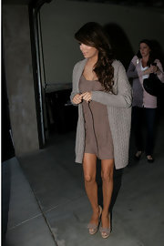 Eva Longoria teamed her taupe mini dress with matching raffia and suede bow peep toes.