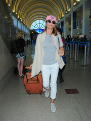 Lori Loughlin teamed her top with a pair of white capris.