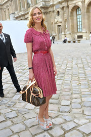 Nora Arnezeder was retro fab in a red print dress and gray platform sandals at the Louis Vuitton fashion show.