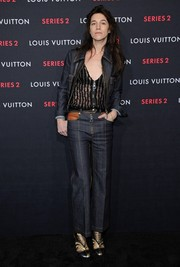 Charlotte Gainsbourg styled her denims with a pair of metallic ankle boots.