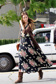 Isabel shows her bohemian chic in this floor length floral print dress.