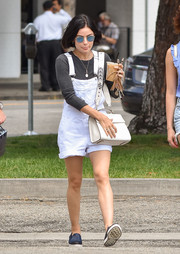 Lucy Hale kept it relaxed in white shortalls by Topshop while out and about in Los Angeles.