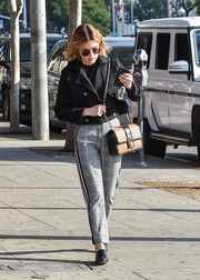 Lucy Hale completed her street-chic attire with side-striped glen plaid pants.