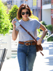 Lucy Hale kept the sun out with a pair of round shades.