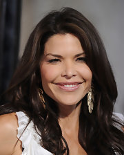 Lauren Sanchez paired her flowing curls with gold leaf earrings.