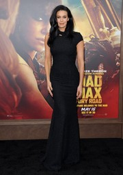 Megan Gale went the modern-glam route in a subtly sparkly, asymmetrical black gown during the 'Mad Max: Fury Road' premiere.