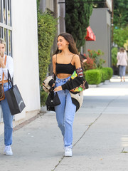 For her arm candy, Madison Beer chose a mini hobo bag by Prada.