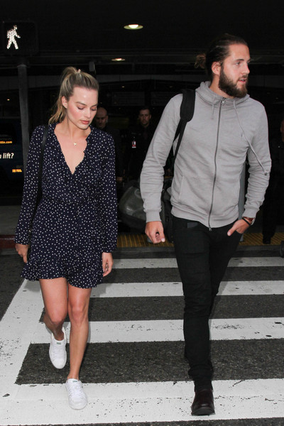 Margot Robbie kept her feet comfy in a pair of white Puma Basket sneakers.