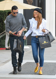 Maria Menounos punched up her casual look with a pair of gold Gucci Princetown slippers.