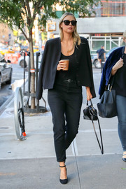Maria Sharapova was spotted out wearing a boxy black cropped jacket over her shoulders.