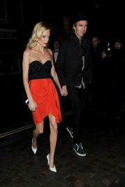 Poppy Delevingne was a leggy beauty during Mario Testino's birthday party in a strapless dress featuring an embellished black bodice and a draped red skirt.