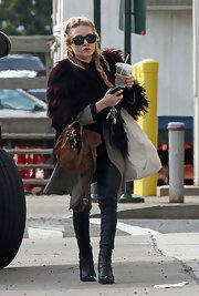 The shabby-chic starlet stepped out with a funky braided, half-up hairstyle.