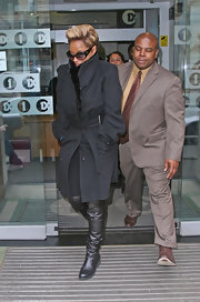 The queen of R&B Mary J Blige heads out of Radio 1 studios bundled up in a black trench coat and over-the-knee flat leather boots.