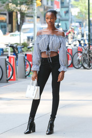 Mayowa Nicholas teamed a white Michael Kors leather purse with a cropped peasant blouse and skinny jeans for a Victoria's Secret fashion show fitting.