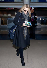 Rachel McAdams looked polished on the go in a flared navy trench and lace-up boots.
