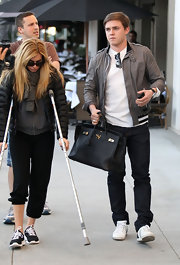 If a guy is going to hold a handbag it might as well be a Birkin!